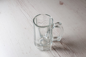 Empty Beer Mug on a light background