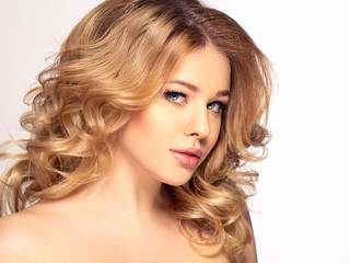 Beauty Blonde Woman Portrait. Beautiful model girl with curly bl