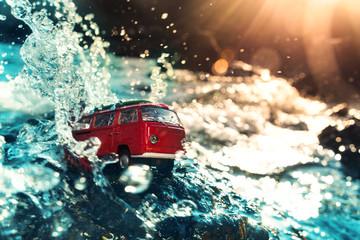 Volkswagen microbus in water.