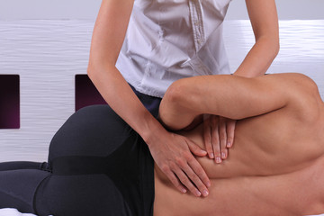 Chiropractic, osteopathy, manual therapy. Therapist doing healing treatment on man's back . Alternative medicine, pain relief concept