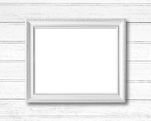 White blank picture frame on wood wall.