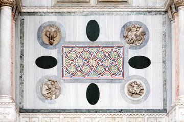 Medieval Venetian Gothic ornaments on the San Marco Basilica facade in Venice, Italyfac