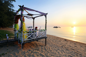 Romantic sunset dinner set up for couple by the beach