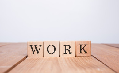 The word WORK over wood background
