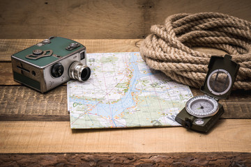 map, rope, camera and compass