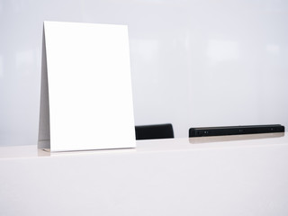 Mock up White template Menu frame on Table Counter Office Business Background