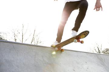 Action Shot Of Skateboarder's Feet With Skateboard