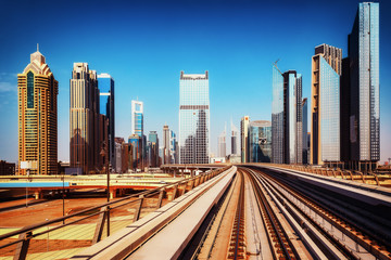 Modern architecture of Dubai, UAE, seen from a metro car. Scenic view of the Dubai skyscrapers. Travel background.