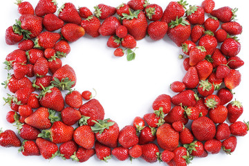 Heart made from Strawberry on white background. Copy space. Top view, High resolution product.