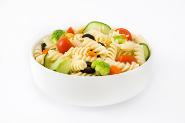 Pasta salad in a bowl isolated on white background