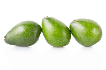 Avocados group isolated on white, clipping path