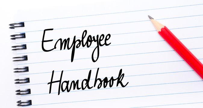 Employee Handbook written on notebook page