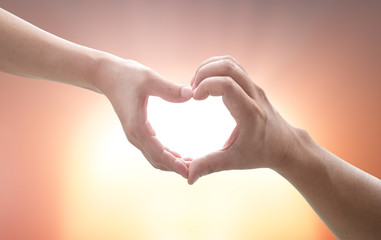 Two Human hands show heart shape.