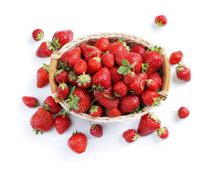 Organic strawberry in wicker basket isolated on white background. Top view, High resolution product.