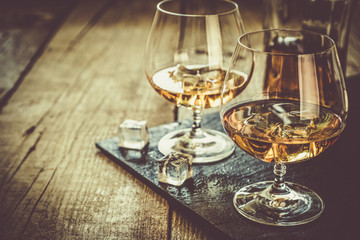 Cognac in glasses on rustic backgrpund