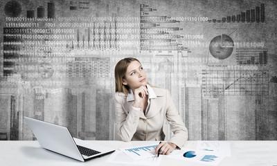 Preparing her financial report