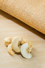 cashew nuts, group of cashew nuts isolated on table.