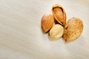 group of almonds isolated on table.