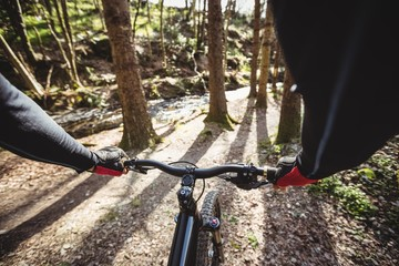 Cropped image of mountain biker riding bicycle