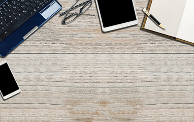 Office wooden desk table with computer, tablet,smartphone,blank