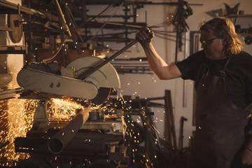 Blacksmith using circular saw machine