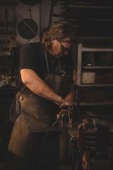 Blacksmith working on metal