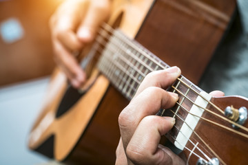 Acoustic Guitar Playing. Men Playing Acoustic Guitar Closeup Pho
