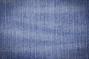 Closeup denim jeans texture or denim jeans background for design with copy space for text or image. Dark edged.