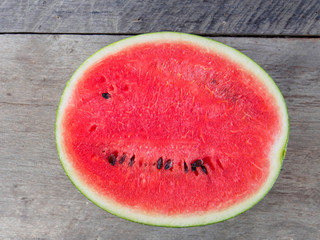 Watermelon slice on wooden
