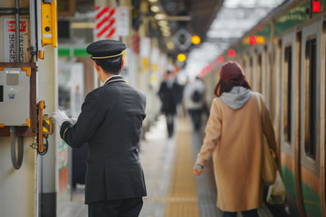 Unidentified Japanese train conductor at a train station in Tokyo, Japan