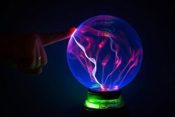 finger on the plasma ball, ball of light Tesla.
