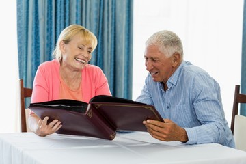 Senior couple looking at photo album