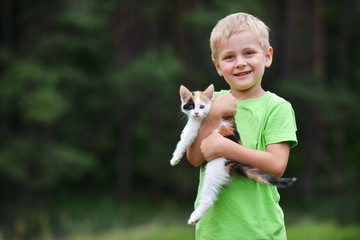 boy  with motley cat