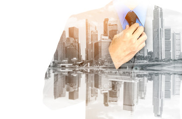 Double exposure of businessman in suit on city background.