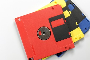 Old color floppy disk. Red, yellow and blue.