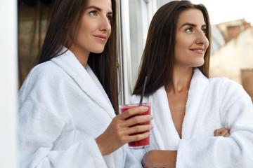 Detox Diet. Healthy Women Drinking Fresh Juice, Smoothie Indoors
