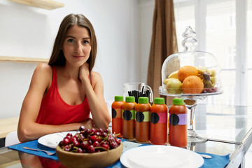Healthy Food. Woman With Detox Smoothie In Kitchen. Nutrition