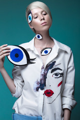 Fashionable girl: natural make-up, clothes with picture in style of pop art. Creative image. Beauty face.