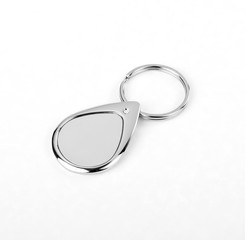 Silver key chain with chain and rings on white background