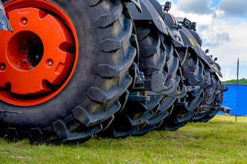 Wall Mural - Close up of tractor tire, Wheel tractor,selective focus.
