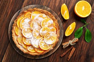 Sweet pie with orange caramelized slices