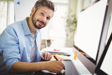 Portrait of businessman working in creative office