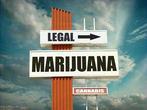 aged and worn vintage legal marijuana sign
