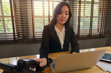 woman working in office and use telephone