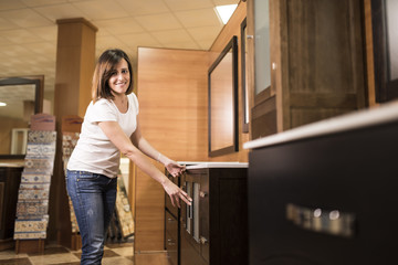 Woman in bathroom furniture store