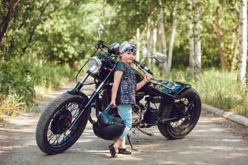 Little girl on a motorcycle.