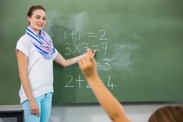 Teacher teaching mathematics in classroom