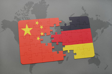 puzzle with the national flag of china and germany on a world map background.