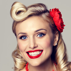 happy smiling woman, dressed in pin-up style