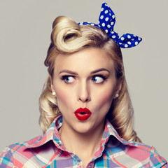 young surprised woman, dressed in pin-up style